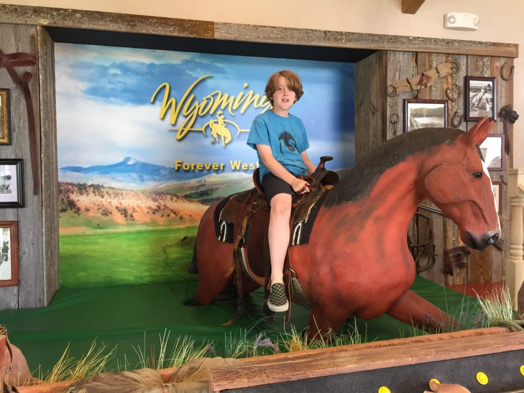 riding a horse at the Wyoming Welcome center on I-90