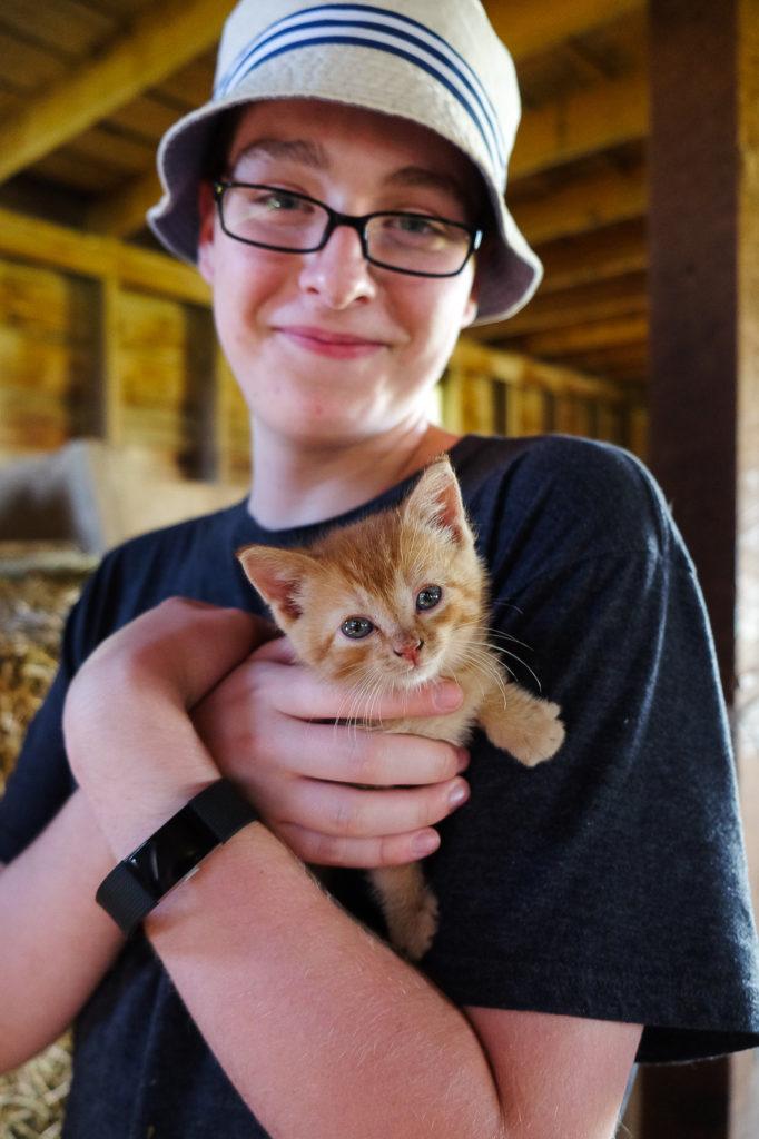 Ari holding a kitten