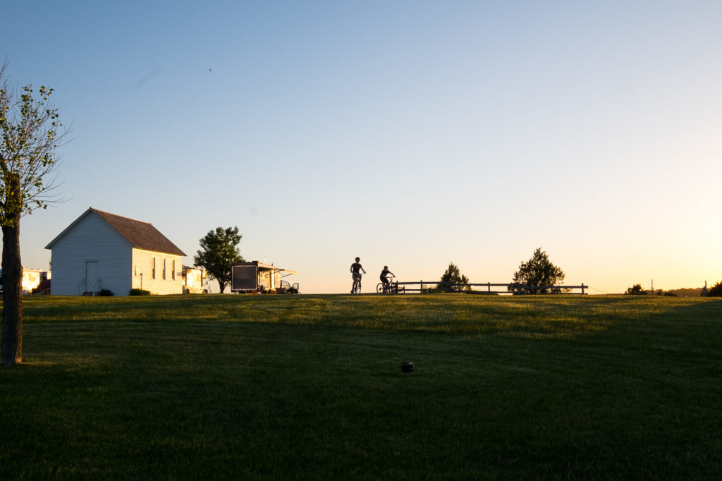 riding bikes at sunset at the Ingalls Homestead